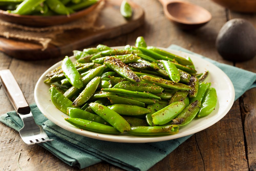 Vegetables, cooked snap peas on a plate