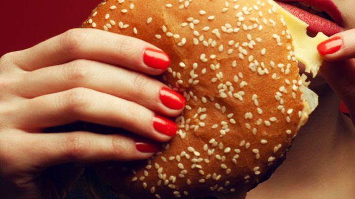 cheat meals good, a burger with manicured nails