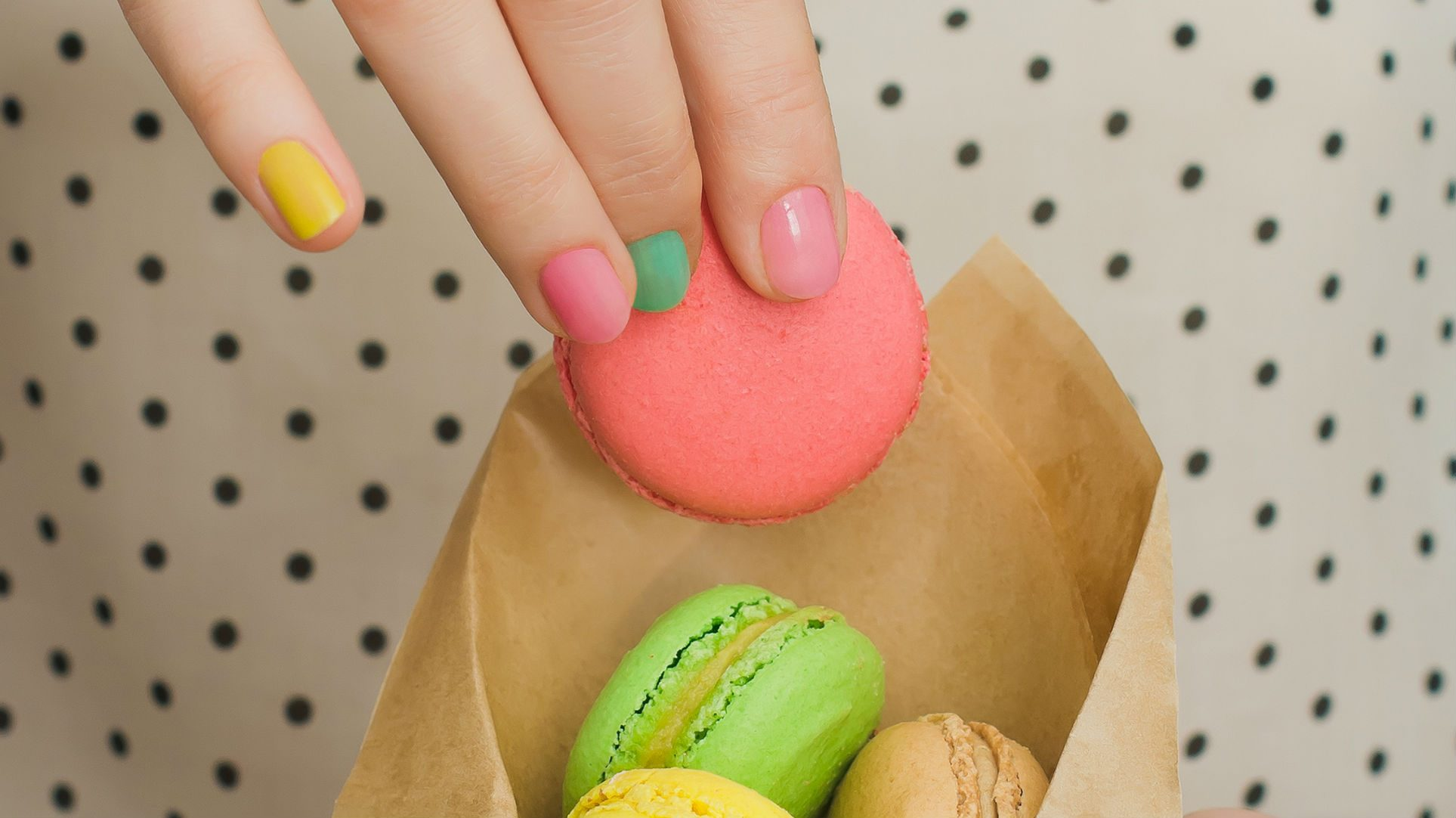 cheat meals good, a woman holding macarons