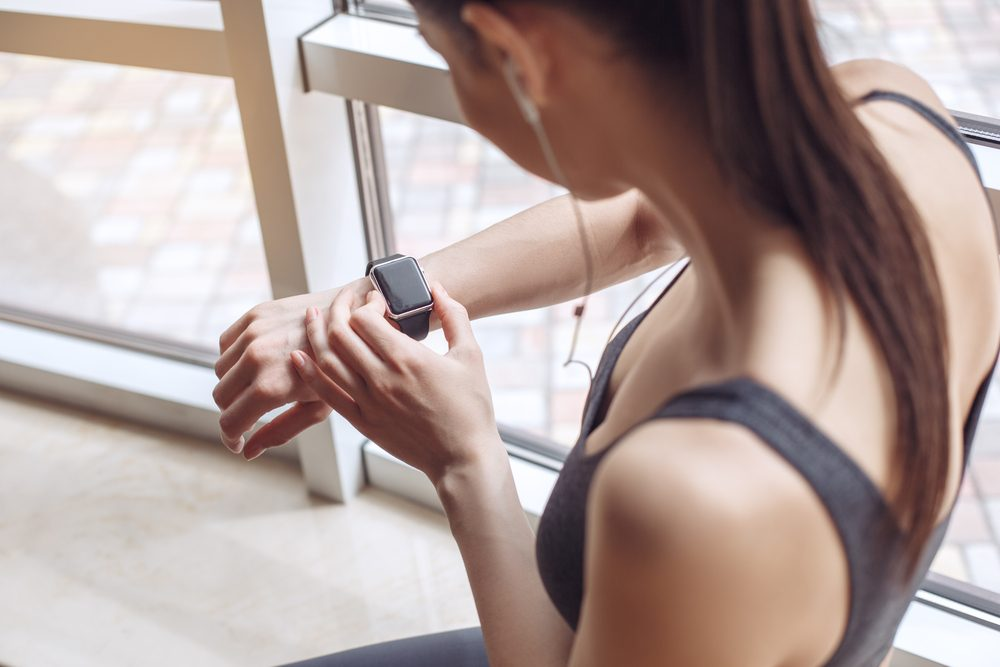 maximize your workout_woman checking watch