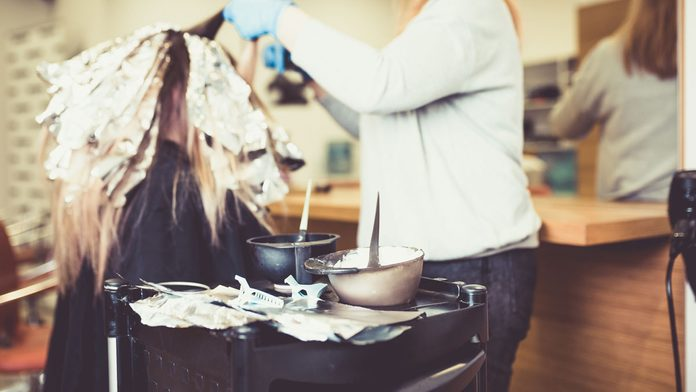 woman with shiny hair at the salon