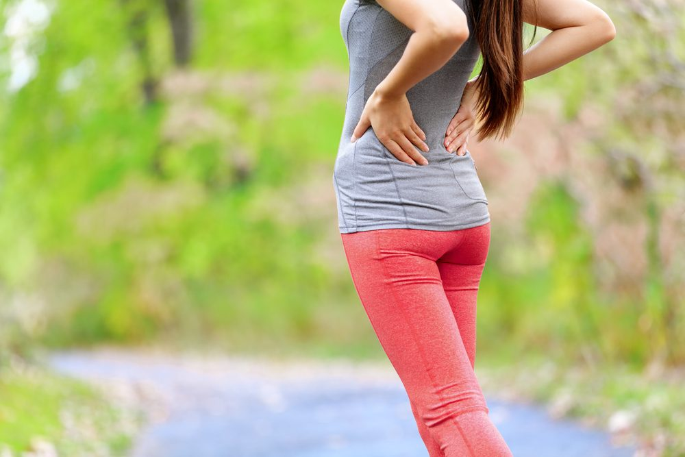 woman whose back is hurting