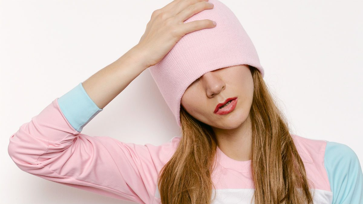 Christmas without migraines, woman holding her head and covering her eyes