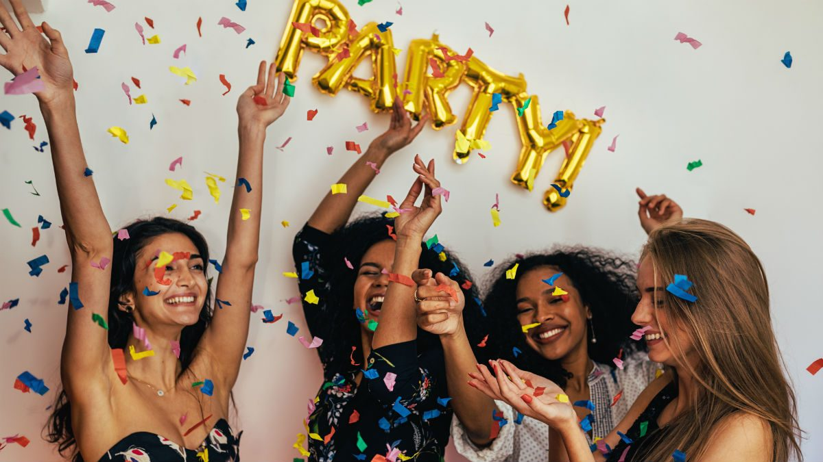 New Year's Eve party recipes, women having a good time at a party