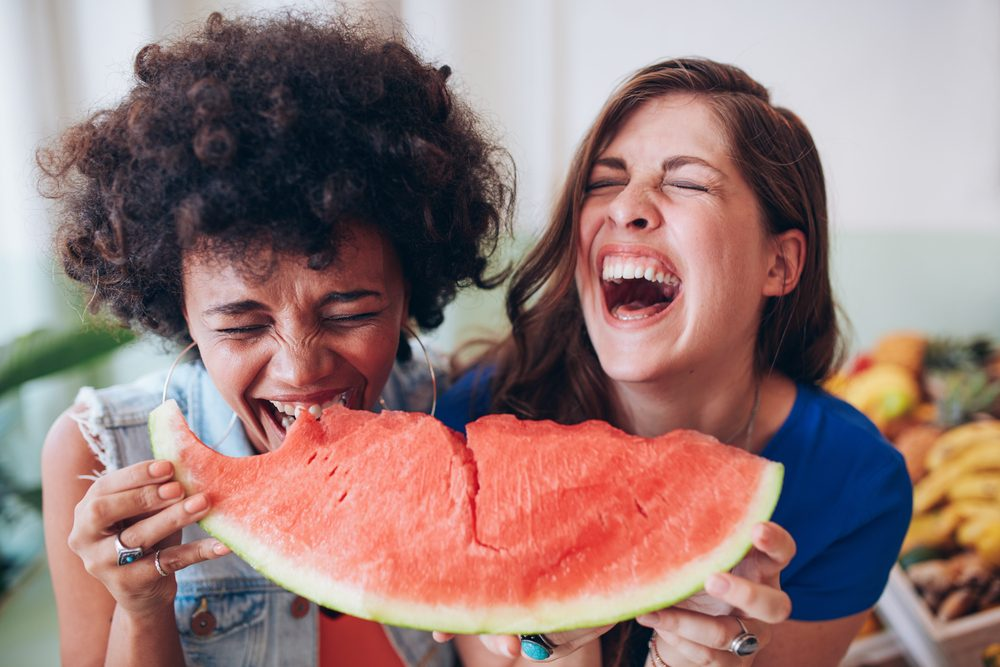 lose weight this summer_women eating watermelon