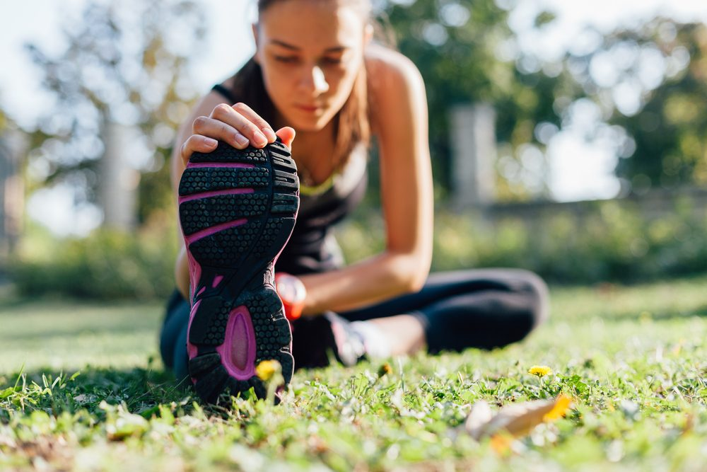 lose weight this summer_woman stretching