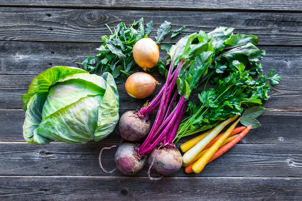 Vegetables, a mix of veggies on a wooden table