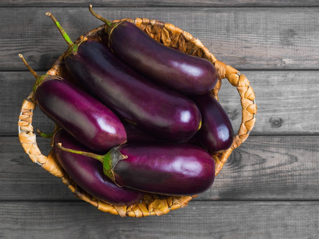 Nightshade vegetables, Basket of purple eggplants