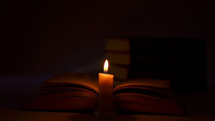 the history of the G Spot, a book with a candle
