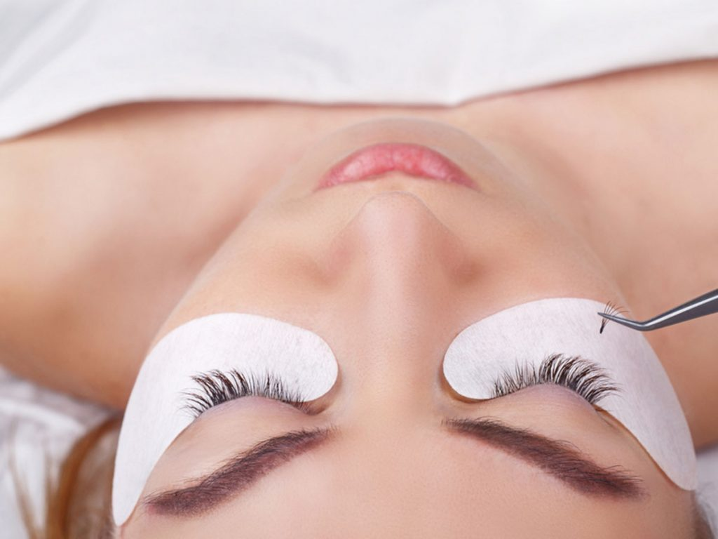 eyelash extensions, lashes getting put on woman