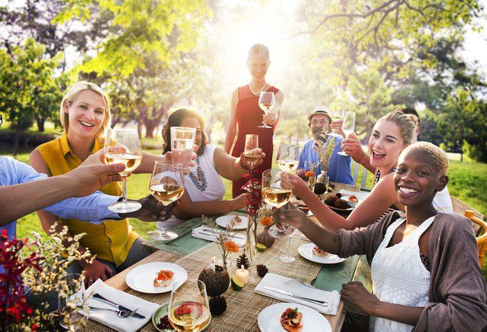 summer health hazards 9_friends eating dinner outside