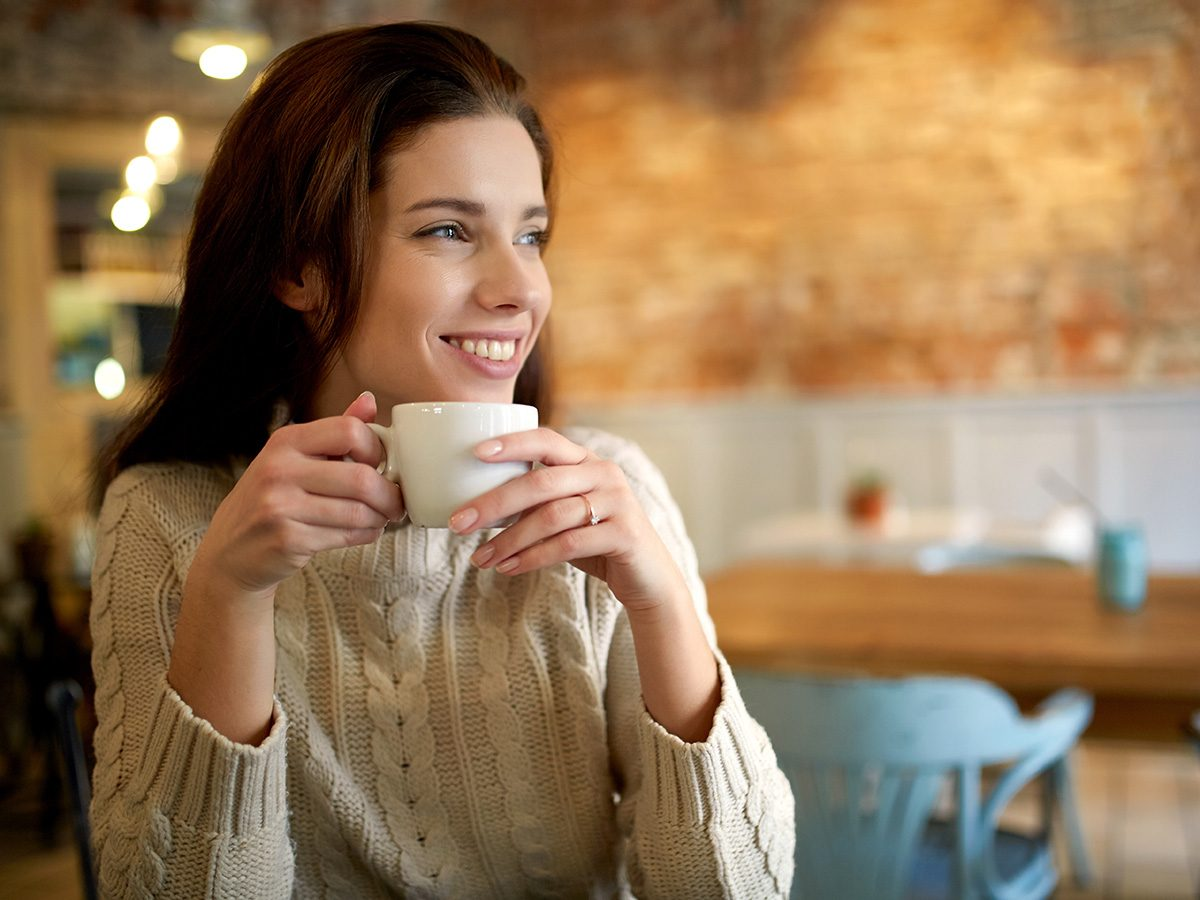 Caffeine, smiling woman drinking coffee