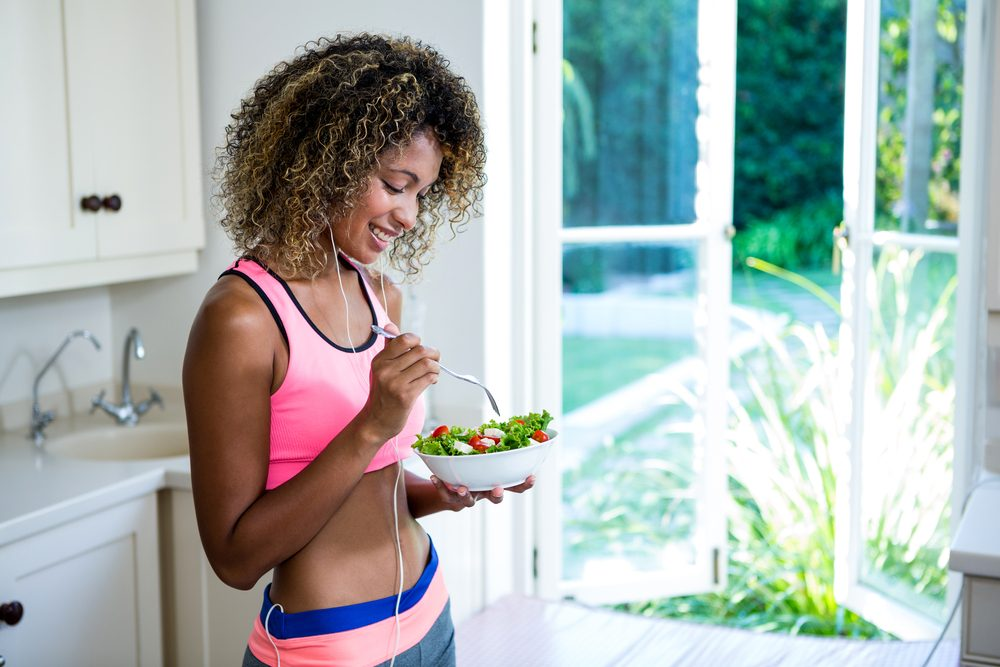 woman eating salad_proven weight loss strategies