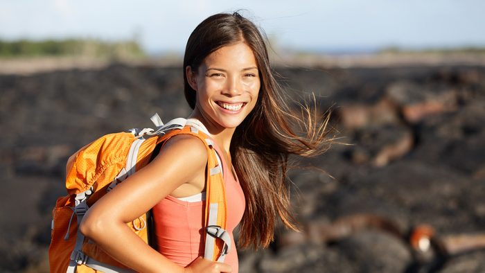 Hiking snacks: woman with a backpack hitting the trail