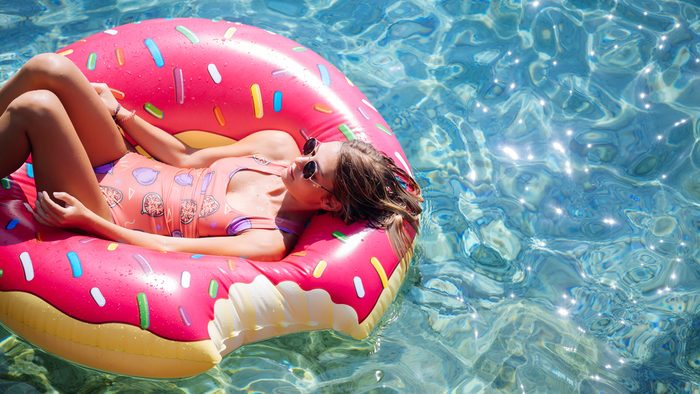 after waxing care woman swimming in donut