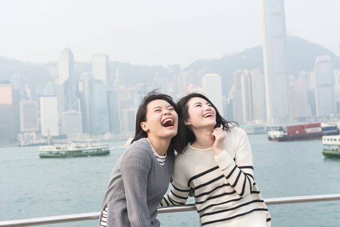 woman laughing_women hurt their health