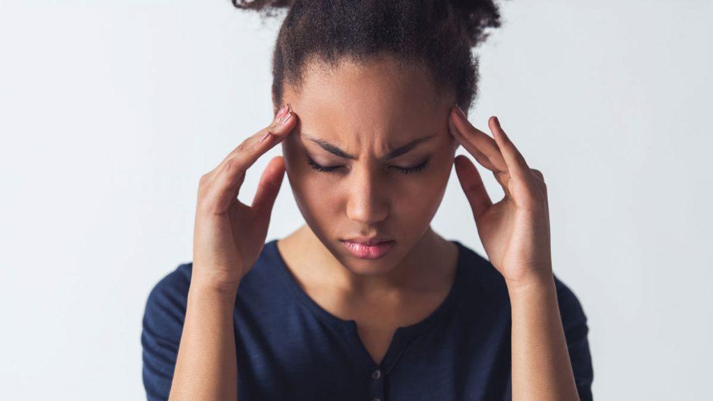 woman has a headache