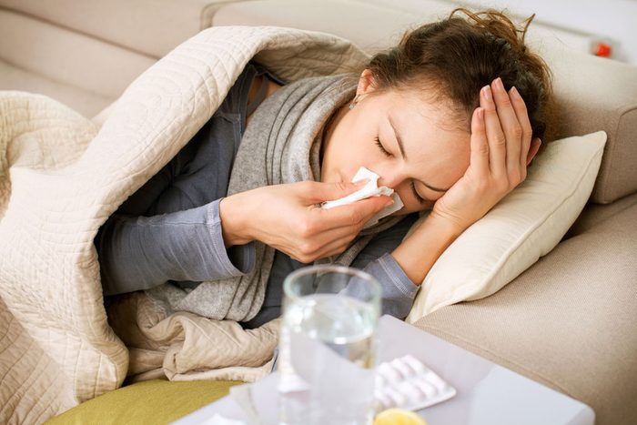 stay healthy during the holidays - woman sick