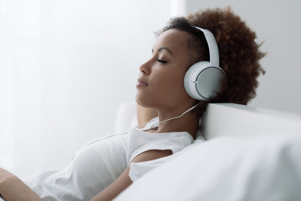 woman listening to audio book _get deeper sleep