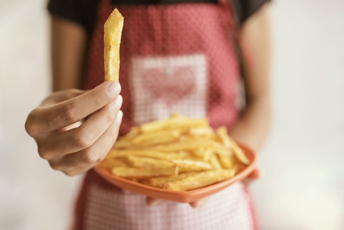woman eating fries