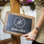 Sex and celiac disease, woman holding gluten-free sign