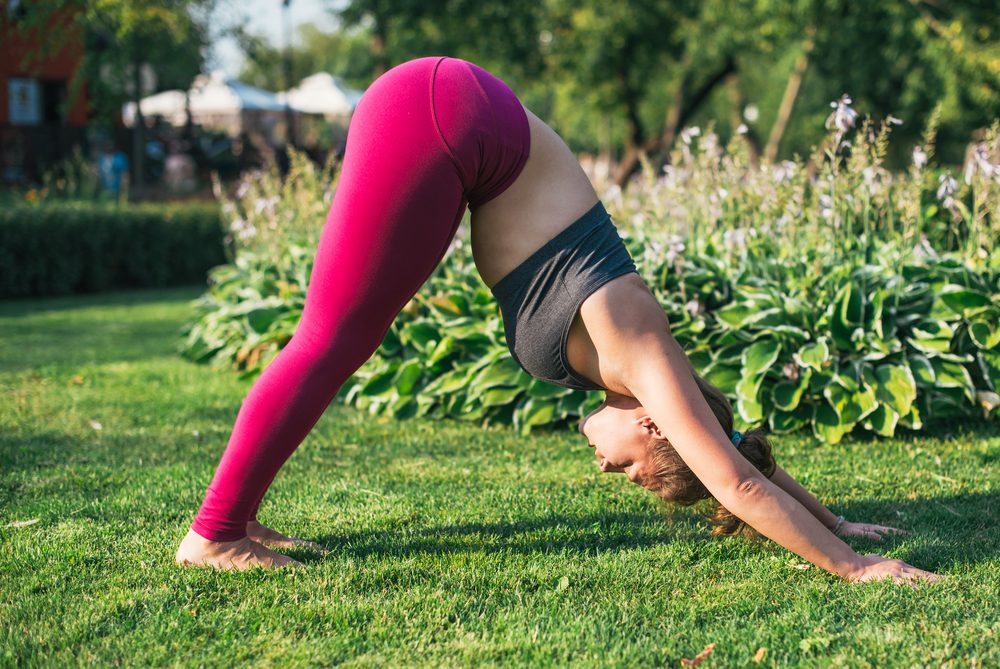 mental health facts _woman doing yoga outside