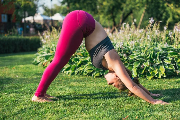 mental health facts _woman doing yoga outside