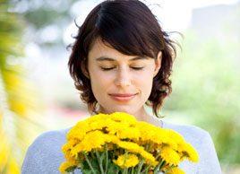 woman flowers spring allergies outdoor