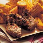 Jerk pork with grilled pineapple and corn