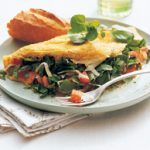 Watercress, cheddar and tomato omelette