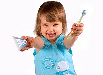 Toddler with a toothbrush and toothpaste