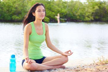 mediation paddleboarding yoga beach