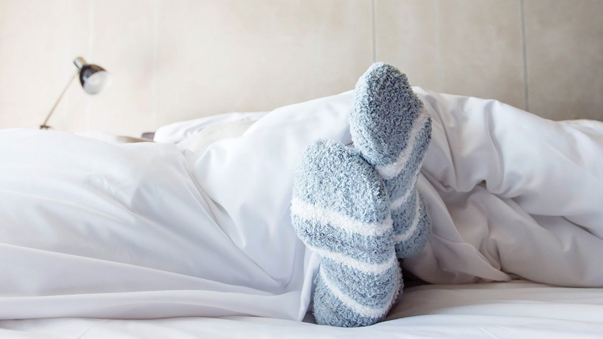 When to call in sick, woman in bed comfy