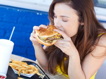 woman eating burger habit