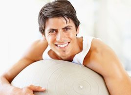 man on exercise ball