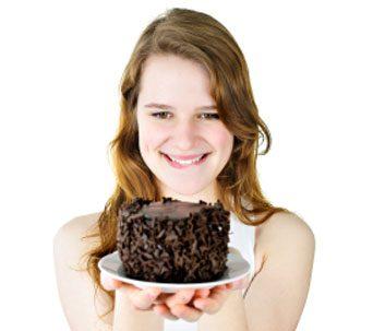 woman indulge in cake