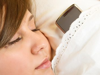 woman sleeping with cellphone