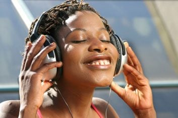 woman smiling with headphones