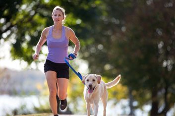 womanrunningwithdogfitness
