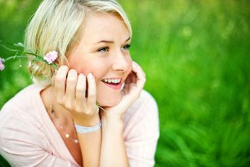 woman smiling grass happy blonde