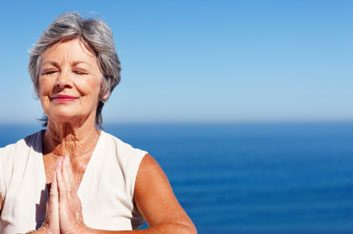 older woman meditating relax