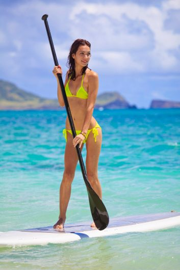 stand-up paddleboarding beach