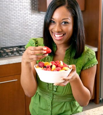 woman eating fruit strawberries