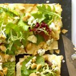 Lavash Pizza with a Salad of Greens, Gorgonzola and Toasted Almonds