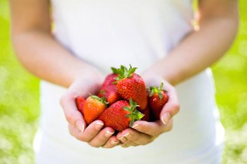 strawberries in hand