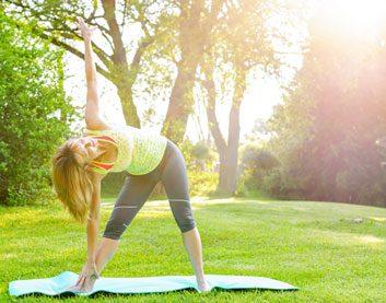triangle pose yoga fitness mature woman