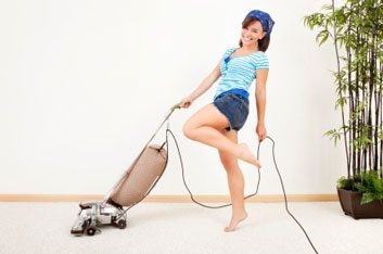 woman vacuuming and cleaning