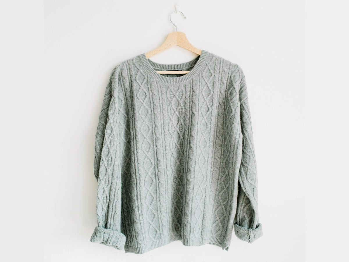 flattering oversized sweater, grey sweater on a hanger