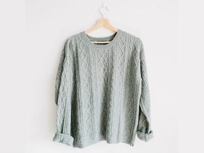flattering oversized sweater, grey sweater on a hanger