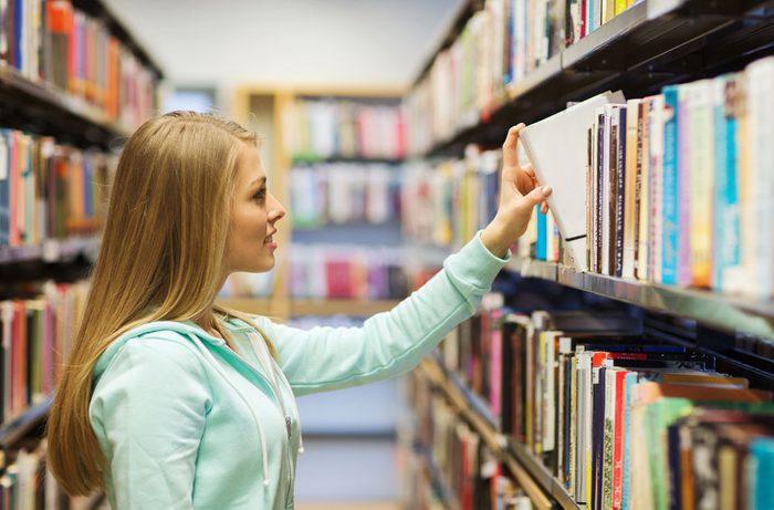 woman choosing a library book